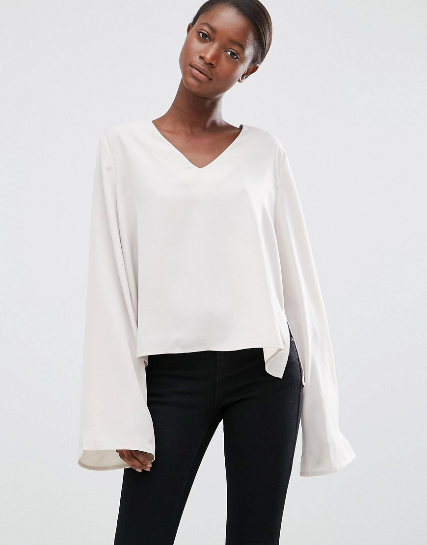 Moves Enny Flared Sleeve Blouse Bone - neckline: v-neck; sleeve style: bell sleeve; pattern: plain; style: blouse; predominant colour: ivory/cream; occasions: casual, evening, creative work; length: standard; fibres: polyester/polyamide - 100%; fit: body skimming; hip detail: subtle/flattering hip detail; sleeve length: long sleeve; pattern type: fabric; texture group: jersey - stretchy/drapey; wardrobe: basic; season: a/w 2016