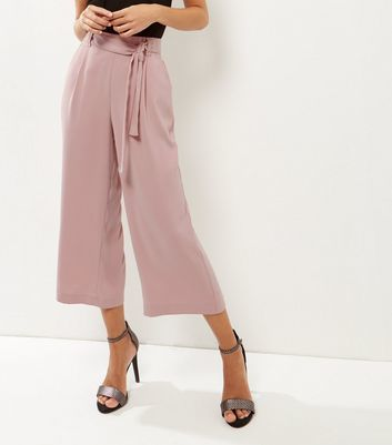 Mid Pink Tie Waist Culottes - pattern: plain; style: palazzo; waist: high rise; waist detail: belted waist/tie at waist/drawstring; predominant colour: blush; occasions: casual, creative work; length: calf length; fibres: polyester/polyamide - stretch; texture group: crepes; fit: wide leg; pattern type: fabric; wardrobe: basic; season: a/w 2016