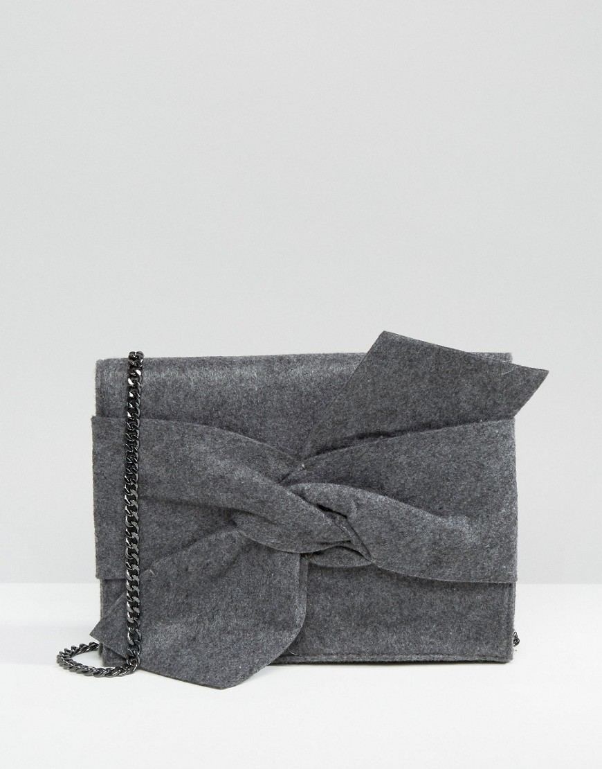 Melton Bow Bag Grey - predominant colour: charcoal; occasions: evening, occasion; type of pattern: standard; style: clutch; length: across body/long; size: standard; pattern: plain; finish: plain; material: felt; embellishment: bow; season: a/w 2016; wardrobe: event