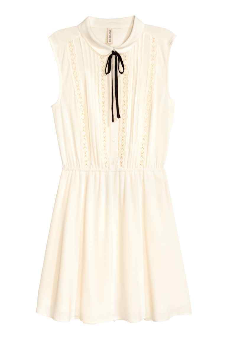Sleeveless Dress - style: shirt; length: mid thigh; pattern: plain; sleeve style: sleeveless; neckline: pussy bow; predominant colour: ivory/cream; secondary colour: black; occasions: casual; fit: body skimming; fibres: viscose/rayon - 100%; sleeve length: sleeveless; texture group: crepes; pattern type: fabric; season: a/w 2016; wardrobe: highlight