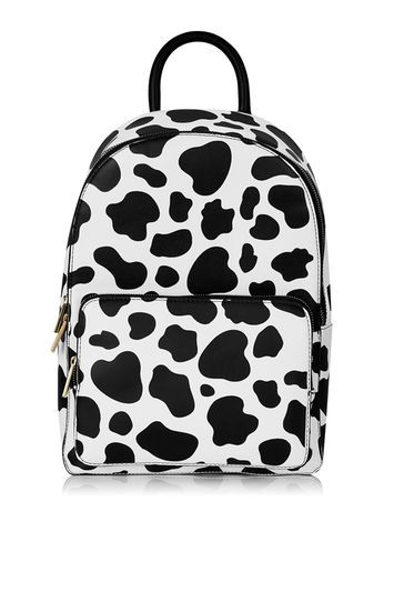 Cow Print Backpack By Skinnydip - predominant colour: white; secondary colour: black; occasions: casual, creative work; type of pattern: light; style: rucksack; length: rucksack; size: standard; material: plastic/rubber; pattern: animal print; finish: plain; season: a/w 2016