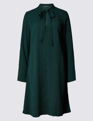 Bow Tie Long Sleeve Tunic Dress - style: tunic; pattern: plain; neckline: pussy bow; predominant colour: dark green; occasions: evening; length: just above the knee; fit: soft a-line; fibres: polyester/polyamide - 100%; sleeve length: long sleeve; sleeve style: standard; pattern type: fabric; texture group: jersey - stretchy/drapey; season: a/w 2016; wardrobe: event