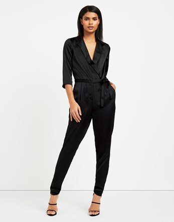Wrap Jumpsuit - length: standard; neckline: v-neck; fit: tailored/fitted; pattern: plain; predominant colour: black; occasions: evening, occasion; fibres: polyester/polyamide - 100%; sleeve length: half sleeve; sleeve style: standard; texture group: structured shiny - satin/tafetta/silk etc.; style: jumpsuit; pattern type: fabric; season: a/w 2016; wardrobe: event