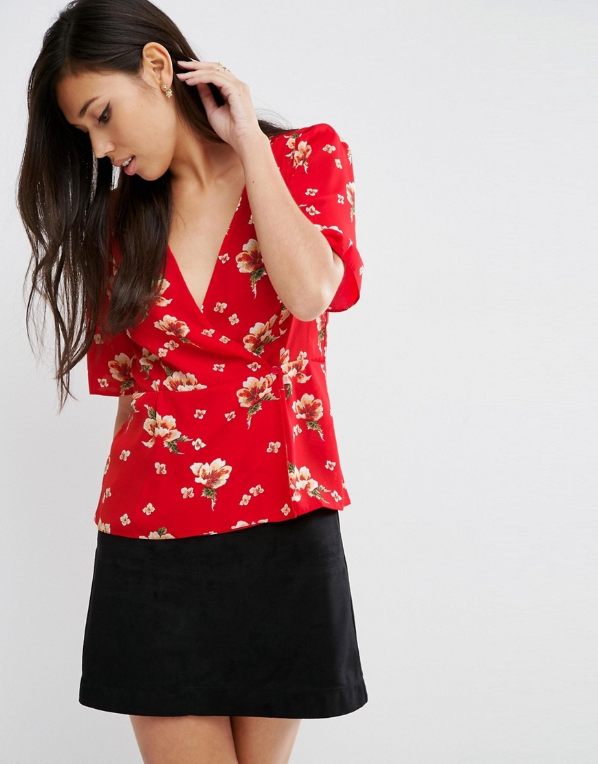 Wrap Tea Blouse In Red Floral Print Multi - neckline: low v-neck; style: wrap/faux wrap; predominant colour: true red; occasions: work, creative work; length: standard; fibres: polyester/polyamide - 100%; fit: straight cut; sleeve length: half sleeve; sleeve style: standard; pattern type: fabric; pattern size: standard; pattern: patterned/print; texture group: other - light to midweight; season: a/w 2016; wardrobe: highlight