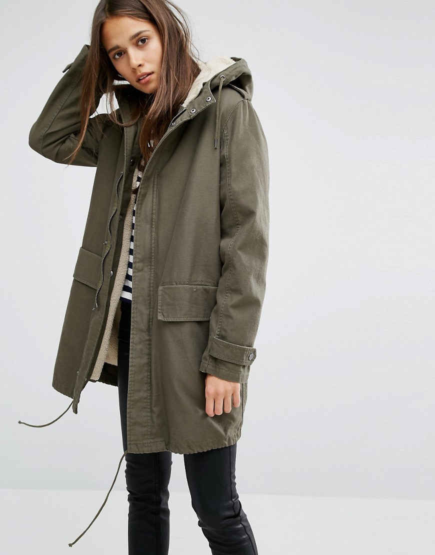Elisa Classic Parka Jacket In Canvas With Borg Lining Khaki - pattern: plain; collar: funnel; fit: loose; style: parka; back detail: hood; length: mid thigh; predominant colour: khaki; occasions: casual; fibres: cotton - 100%; sleeve length: long sleeve; sleeve style: standard; collar break: high; pattern type: fabric; texture group: woven bulky/heavy; wardrobe: basic; season: a/w 2016