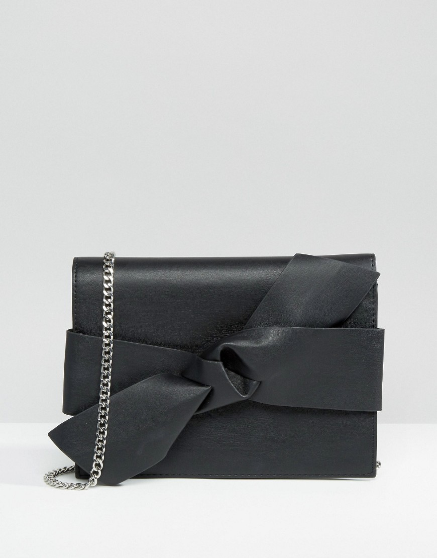 Bow Detail Cross Body Bag Black - predominant colour: black; occasions: evening, occasion; type of pattern: standard; style: shoulder; length: across body/long; size: standard; material: faux leather; pattern: plain; finish: plain; embellishment: chain/metal; season: a/w 2016; wardrobe: event