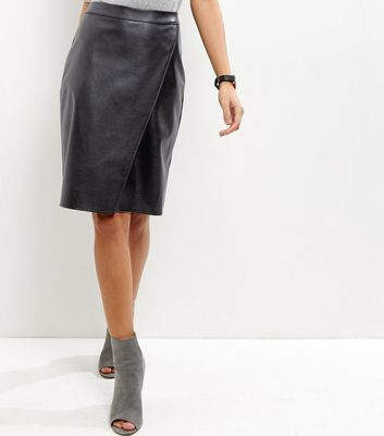Black Leather Look Wrap Front Midi Skirt - pattern: plain; style: wrap/faux wrap; fit: tailored/fitted; waist: mid/regular rise; predominant colour: black; occasions: evening, creative work; length: just above the knee; fibres: leather - 100%; texture group: leather; pattern type: fabric; season: a/w 2016; wardrobe: highlight
