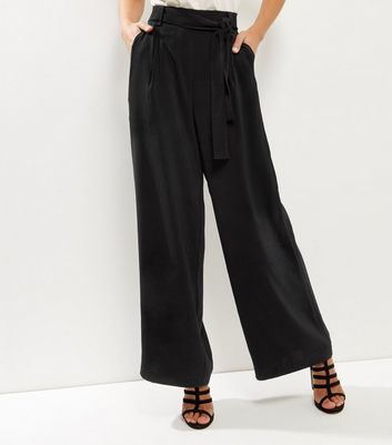 Black Self Tie Wide Leg Trousers - length: standard; pattern: plain; waist detail: belted waist/tie at waist/drawstring; waist: mid/regular rise; predominant colour: black; occasions: evening, creative work; fibres: polyester/polyamide - stretch; fit: wide leg; pattern type: fabric; texture group: woven light midweight; style: standard; pattern size: standard (bottom); wardrobe: basic; season: a/w 2016