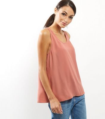 Peach Cross Back Vest - pattern: plain; sleeve style: sleeveless; style: vest top; predominant colour: pink; occasions: casual; length: standard; neckline: scoop; fibres: polyester/polyamide - 100%; fit: loose; sleeve length: sleeveless; pattern type: fabric; texture group: jersey - stretchy/drapey; season: a/w 2016; wardrobe: highlight