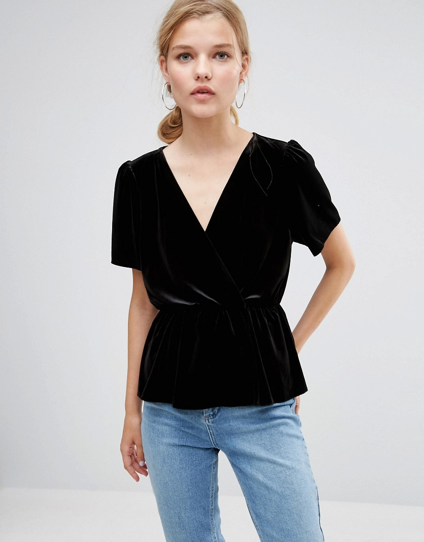 Velvet Wrap Tea Blouse Black - neckline: low v-neck; pattern: plain; waist detail: fitted waist; style: wrap/faux wrap; predominant colour: black; occasions: casual, work, creative work; length: standard; fibres: polyester/polyamide - stretch; fit: tailored/fitted; sleeve length: short sleeve; sleeve style: standard; pattern type: fabric; texture group: velvet/fabrics with pile; season: a/w 2016; wardrobe: highlight