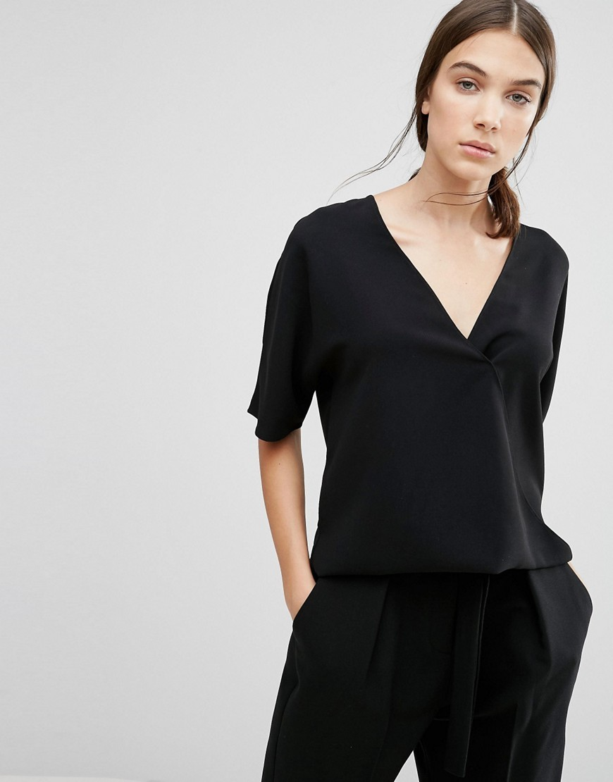 Arrow Crepe Wrapover Top Black - neckline: low v-neck; pattern: plain; style: wrap/faux wrap; predominant colour: black; occasions: casual, work, creative work; length: standard; fit: body skimming; sleeve length: half sleeve; sleeve style: standard; texture group: crepes; pattern type: fabric; fibres: viscose/rayon - mix; wardrobe: basic; season: a/w 2016