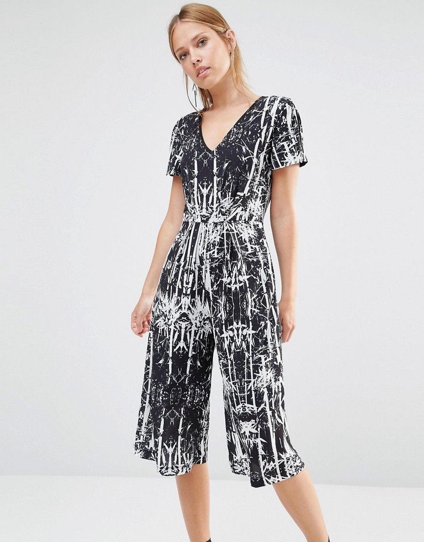 Palm Print Culotte Jumpsuit Black - neckline: low v-neck; hip detail: fitted at hip; secondary colour: white; predominant colour: black; occasions: evening; length: calf length; fit: body skimming; fibres: polyester/polyamide - 100%; sleeve length: short sleeve; sleeve style: standard; style: jumpsuit; pattern type: fabric; pattern: patterned/print; texture group: jersey - stretchy/drapey; multicoloured: multicoloured; season: a/w 2016; wardrobe: event