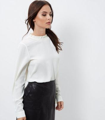 Cream Ruffle Trim Long Sleeve Top - pattern: plain; neckline: high neck; predominant colour: ivory/cream; occasions: casual; length: standard; style: top; fibres: polyester/polyamide - 100%; fit: loose; sleeve length: long sleeve; sleeve style: standard; texture group: knits/crochet; pattern type: knitted - fine stitch; wardrobe: basic; season: a/w 2016