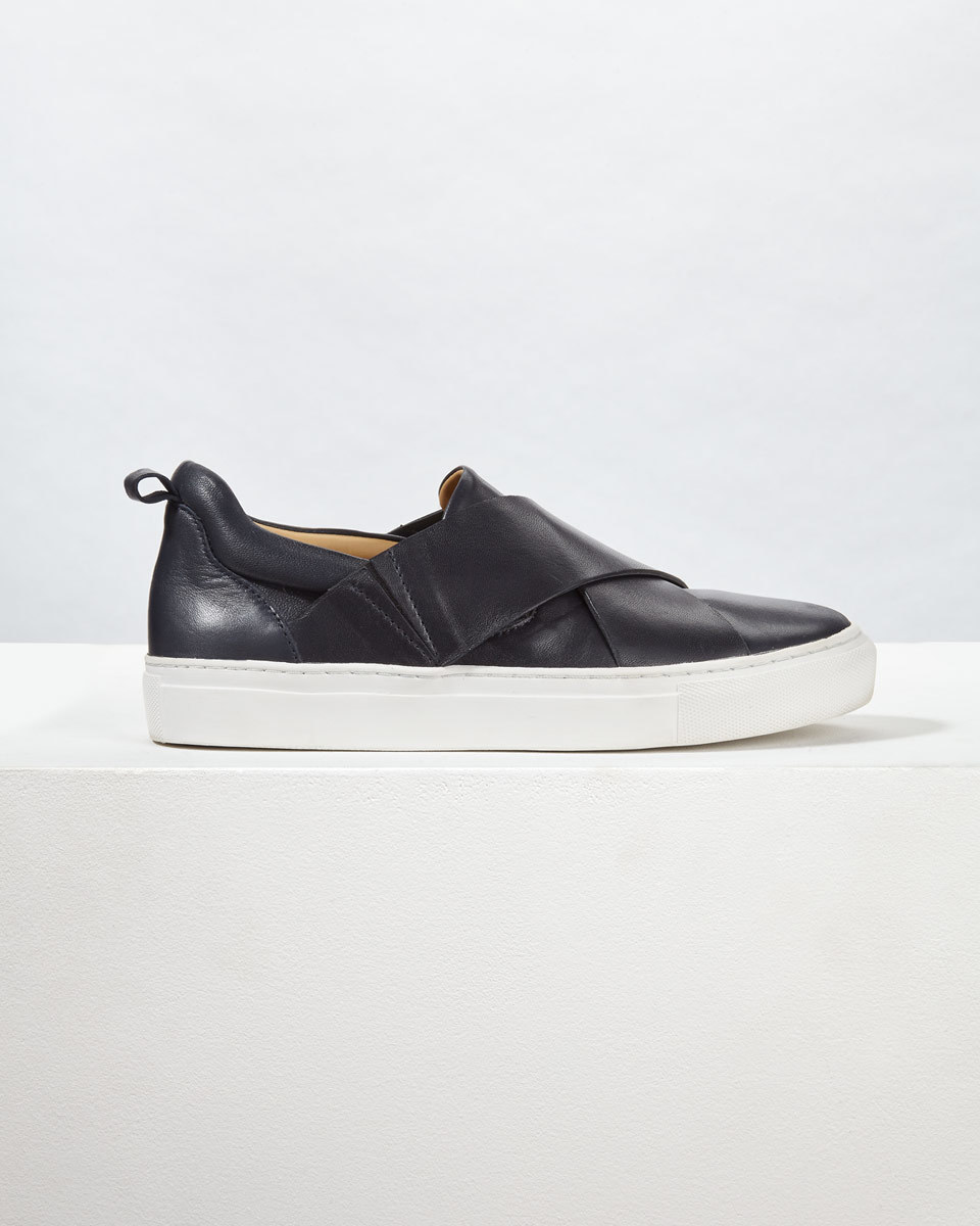 Olivia Cross Strap Trainer - predominant colour: black; occasions: casual; material: leather; heel height: flat; toe: round toe; finish: plain; pattern: plain; shoe detail: platform; style: skate shoes; season: a/w 2016; wardrobe: highlight