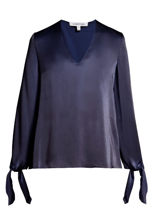 Astrid V Neck Long Sleeved Satin Blouse - neckline: v-neck; pattern: plain; style: blouse; predominant colour: navy; occasions: work, occasion; length: standard; fibres: polyester/polyamide - 100%; fit: loose; sleeve length: long sleeve; sleeve style: standard; texture group: structured shiny - satin/tafetta/silk etc.; pattern type: fabric; wardrobe: basic; season: a/w 2016