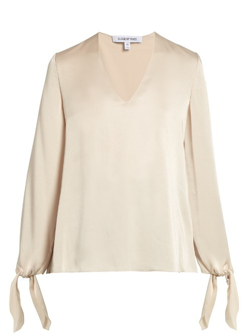 Astrid V Neck Long Sleeved Satin Blouse - neckline: v-neck; pattern: plain; length: below the bottom; style: blouse; predominant colour: ivory/cream; occasions: evening, creative work; fibres: polyester/polyamide - 100%; fit: loose; sleeve length: long sleeve; sleeve style: standard; pattern type: fabric; texture group: other - light to midweight; wardrobe: basic; season: a/w 2016