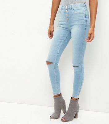 Blue Ripped Knee Skinny Jeans - style: skinny leg; pattern: plain; waist: high rise; pocket detail: traditional 5 pocket; predominant colour: pale blue; occasions: casual; length: ankle length; fibres: cotton - stretch; jeans detail: washed/faded, rips; texture group: denim; pattern type: fabric; wardrobe: basic; season: a/w 2016