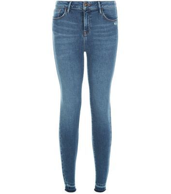 Blue Fray Hem Skinny Jeans - style: skinny leg; length: standard; pattern: plain; pocket detail: traditional 5 pocket; waist: mid/regular rise; predominant colour: denim; occasions: casual; fibres: cotton - stretch; jeans detail: whiskering, shading down centre of thigh; texture group: denim; pattern type: fabric; wardrobe: basic; season: a/w 2016