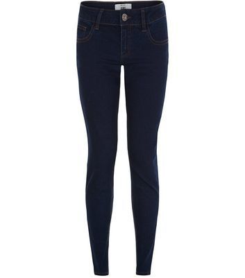 Blue Skinny Jeans - style: skinny leg; length: standard; pattern: plain; pocket detail: traditional 5 pocket; waist: mid/regular rise; predominant colour: navy; occasions: casual; fibres: cotton - stretch; texture group: denim; pattern type: fabric; wardrobe: basic; season: a/w 2016