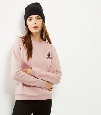 Mid Pink Love Embroidered Acid Washed Sweater - style: sweat top; predominant colour: blush; occasions: casual; length: standard; fibres: cotton - stretch; fit: loose; neckline: crew; sleeve length: long sleeve; sleeve style: standard; pattern type: fabric; pattern size: light/subtle; pattern: patterned/print; texture group: jersey - stretchy/drapey; embellishment: embroidered; season: a/w 2016; wardrobe: highlight