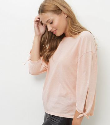 Mid Pink Tie Sleeve T Shirt - neckline: slash/boat neckline; pattern: plain; style: t-shirt; predominant colour: blush; occasions: casual; length: standard; fibres: cotton - stretch; fit: loose; sleeve length: 3/4 length; sleeve style: standard; pattern type: fabric; texture group: jersey - stretchy/drapey; wardrobe: basic; season: a/w 2016