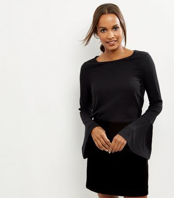 Black Ribbed Bell Sleeve Top - sleeve style: bell sleeve; pattern: plain; predominant colour: black; occasions: casual, creative work; length: standard; style: top; neckline: scoop; fibres: polyester/polyamide - 100%; fit: body skimming; sleeve length: long sleeve; pattern type: fabric; texture group: jersey - stretchy/drapey; wardrobe: basic; season: a/w 2016