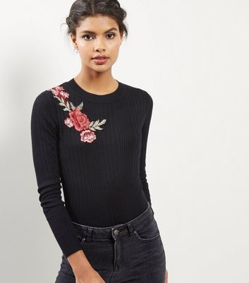 Black Ribbed Floral Embroidered Top - neckline: round neck; pattern: plain; secondary colour: coral; predominant colour: black; occasions: casual, work, creative work; length: standard; style: top; fibres: polyester/polyamide - 100%; fit: tight; sleeve length: long sleeve; sleeve style: standard; pattern type: fabric; texture group: jersey - stretchy/drapey; embellishment: embroidered; season: a/w 2016; wardrobe: highlight