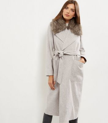 Cream Faux Fur Collar Belted Longline Coat - pattern: plain; back detail: hood; style: wrap around; predominant colour: light grey; occasions: casual; fit: tailored/fitted; fibres: polyester/polyamide - mix; length: below the knee; waist detail: belted waist/tie at waist/drawstring; sleeve length: long sleeve; sleeve style: standard; collar: fur; collar break: medium; pattern type: fabric; texture group: woven bulky/heavy; wardrobe: basic; season: a/w 2016