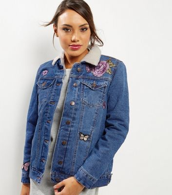 Blue Denim Floral Embroidered Borg Trim Jacket - style: denim; predominant colour: denim; occasions: casual; length: standard; fit: straight cut (boxy); fibres: cotton - 100%; collar: shirt collar/peter pan/zip with opening; sleeve length: long sleeve; sleeve style: standard; texture group: denim; collar break: high; pattern type: fabric; pattern: florals; embellishment: embroidered; season: a/w 2016; wardrobe: highlight; embellishment location: bust