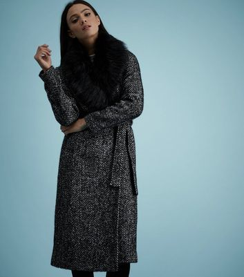 Black Faux Fur Collar Belted Longline Coat - pattern: plain; style: wrap around; fit: slim fit; predominant colour: charcoal; secondary colour: black; occasions: casual; fibres: polyester/polyamide - mix; length: below the knee; waist detail: belted waist/tie at waist/drawstring; sleeve length: long sleeve; sleeve style: standard; collar: fur; collar break: high; pattern type: fabric; texture group: woven bulky/heavy; multicoloured: multicoloured; wardrobe: basic; season: a/w 2016