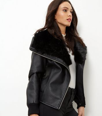 Black Faux Fur Leather Look Bomber Jacket - pattern: plain; length: standard; collar: wide lapels; fit: loose; predominant colour: black; occasions: casual; fibres: polyester/polyamide - 100%; sleeve length: long sleeve; sleeve style: standard; texture group: leather; collar break: medium; pattern type: fabric; style: biker; season: a/w 2016