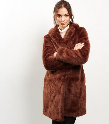 Brown Faux Fur Coat - pattern: plain; fit: loose; length: mid thigh; predominant colour: burgundy; occasions: casual, creative work; fibres: acrylic - 100%; style: fur coat; sleeve length: long sleeve; sleeve style: standard; texture group: fur; collar: fur; collar break: medium; pattern type: fabric; pattern size: standard; season: a/w 2016; wardrobe: highlight
