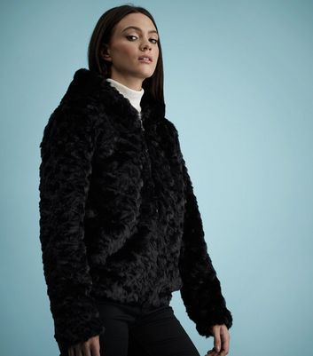 Black Faux Fur Hooded Jacket - pattern: plain; length: standard; fit: loose; back detail: hood; collar: high neck; predominant colour: black; occasions: casual; fibres: polyester/polyamide - 100%; style: fur coat; sleeve length: long sleeve; sleeve style: standard; texture group: fur; collar break: high; pattern type: fabric; season: a/w 2016; wardrobe: highlight