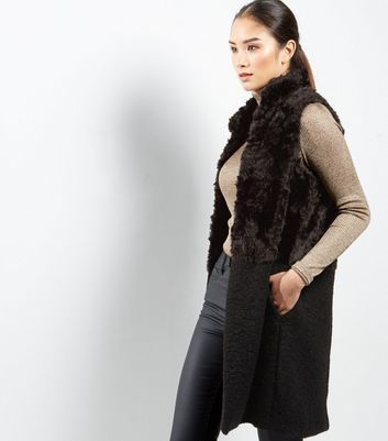 Black Faux Fur Longline High Neck Gilet - pattern: plain; sleeve style: sleeveless; style: gilet; collar: funnel; length: on the knee; predominant colour: black; occasions: casual; fit: straight cut (boxy); fibres: polyester/polyamide - 100%; sleeve length: sleeveless; texture group: fur; collar break: high; pattern type: fabric; season: a/w 2016; wardrobe: highlight