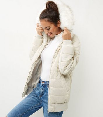 Cream Faux Fur Trim Quilted Hooded Puffer Jacket - pattern: plain; length: standard; collar: funnel; fit: loose; style: parka; back detail: hood; predominant colour: ivory/cream; occasions: casual; fibres: nylon - 100%; sleeve length: long sleeve; sleeve style: standard; collar break: high; pattern type: fabric; texture group: woven bulky/heavy; embellishment: fur; season: a/w 2016; wardrobe: highlight