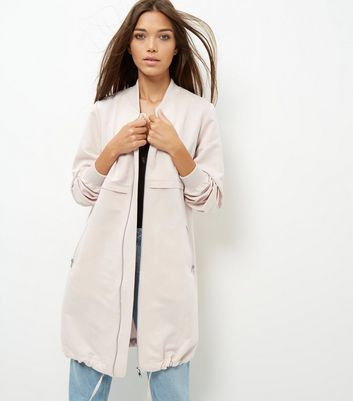 Shell Pink Drawstring Hem Longline Bomber Jacket - pattern: plain; collar: round collar/collarless; fit: loose; length: below the bottom; style: bomber; predominant colour: nude; occasions: casual, creative work; fibres: polyester/polyamide - 100%; sleeve length: long sleeve; sleeve style: standard; texture group: crepes; collar break: low/open; pattern type: fabric; wardrobe: basic; season: a/w 2016