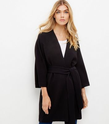 Black Belted Kimono Jacket - sleeve style: dolman/batwing; pattern: plain; collar: round collar/collarless; fit: loose; predominant colour: black; occasions: evening, creative work; fibres: polyester/polyamide - 100%; length: mid thigh; waist detail: belted waist/tie at waist/drawstring; sleeve length: 3/4 length; texture group: crepes; collar break: medium; pattern type: fabric; style: fluid/kimono; season: a/w 2016; wardrobe: highlight