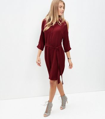 Burgundy Cold Shoulder Shirt Dress - style: shirt; neckline: shirt collar/peter pan/zip with opening; pattern: plain; waist detail: belted waist/tie at waist/drawstring; predominant colour: burgundy; occasions: evening; length: on the knee; fit: body skimming; fibres: polyester/polyamide - stretch; shoulder detail: cut out shoulder; sleeve length: 3/4 length; sleeve style: standard; texture group: crepes; pattern type: fabric; season: a/w 2016; wardrobe: event
