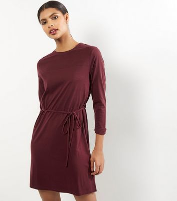 Burgundy Seam Trim Tie Waist Tunic Dress - style: t-shirt; length: mid thigh; pattern: plain; waist detail: belted waist/tie at waist/drawstring; predominant colour: burgundy; occasions: casual; fit: body skimming; fibres: cotton - mix; neckline: crew; sleeve length: 3/4 length; sleeve style: standard; pattern type: fabric; texture group: jersey - stretchy/drapey; season: a/w 2016; wardrobe: highlight