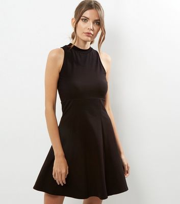 Black High Neck Skater Dress - pattern: plain; sleeve style: sleeveless; predominant colour: black; occasions: evening; length: on the knee; fit: fitted at waist & bust; style: fit & flare; fibres: cotton - 100%; neckline: crew; sleeve length: sleeveless; pattern type: fabric; texture group: jersey - stretchy/drapey; season: a/w 2016; wardrobe: event