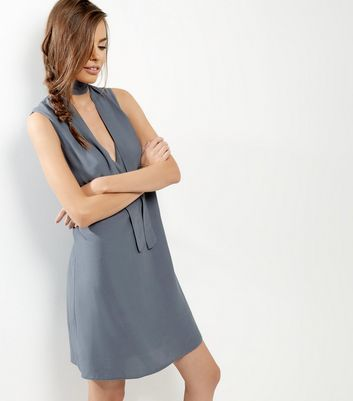 Grey Tie Neck Sleeveless Tunic Dress - style: shift; pattern: plain; sleeve style: sleeveless; neckline: pussy bow; predominant colour: mid grey; occasions: evening; length: just above the knee; fit: body skimming; fibres: viscose/rayon - 100%; sleeve length: sleeveless; texture group: crepes; pattern type: fabric; season: a/w 2016; wardrobe: event
