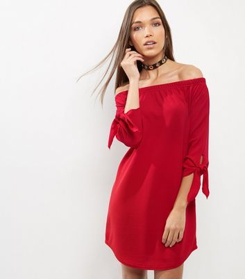 Red Tie Sleeve Bardot Neck Dress - style: trapeze; neckline: off the shoulder; fit: loose; pattern: plain; predominant colour: true red; occasions: evening; length: just above the knee; fibres: polyester/polyamide - stretch; sleeve length: 3/4 length; sleeve style: standard; texture group: sheer fabrics/chiffon/organza etc.; pattern type: fabric; season: a/w 2016; wardrobe: event