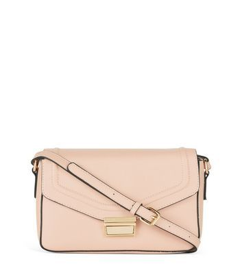 Shell Pink Across Body Bag - predominant colour: blush; occasions: casual, creative work; type of pattern: standard; style: shoulder; length: across body/long; size: standard; material: faux leather; pattern: plain; finish: plain; wardrobe: investment; season: a/w 2016