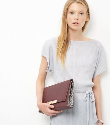 Burgundy Snakeskin Textured Clutch - predominant colour: burgundy; occasions: evening; type of pattern: standard; style: clutch; length: hand carry; size: small; material: faux leather; pattern: plain; finish: plain; season: a/w 2016; wardrobe: event
