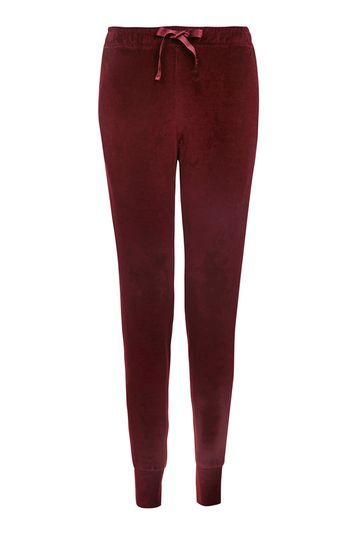 Velvet Joggers - length: standard; pattern: plain; style: tracksuit pants; waist: mid/regular rise; predominant colour: aubergine; occasions: casual; fibres: cotton - mix; hip detail: fitted at hip (bottoms); fit: tapered; pattern type: fabric; texture group: jersey - stretchy/drapey; pattern size: standard (bottom); season: a/w 2016