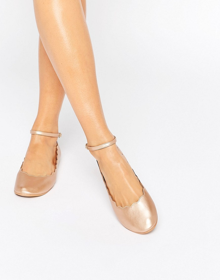 Rose Gold Scallop Edge Ankle Strap Ballerina Rose Gold - predominant colour: gold; occasions: casual, creative work; material: faux leather; heel height: flat; ankle detail: ankle strap; toe: round toe; style: ballerinas / pumps; finish: metallic; pattern: plain; wardrobe: basic; season: a/w 2016