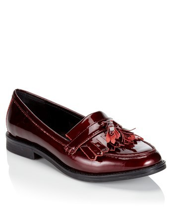Tassel Loafer - predominant colour: burgundy; occasions: casual; material: leather; heel height: flat; embellishment: tassels; toe: round toe; style: loafers; finish: patent; pattern: plain; season: a/w 2016; wardrobe: highlight