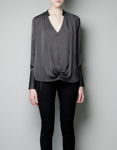 Blouse With Gathering - neckline: low v-neck; pattern: plain; style: blouson; waist detail: twist front waist detail/nipped in at waist on one side/soft pleats/draping/ruching/gathering waist detail; predominant colour: charcoal; occasions: casual, evening; length: standard; fibres: polyester/polyamide - 100%; fit: loose; hip detail: soft pleats at hip/draping at hip/flared at hip; sleeve length: long sleeve; sleeve style: standard; trends: deep tones; texture group: structured shiny - satin/tafetta/silk etc.; pattern type: fabric; season: a/w 2012