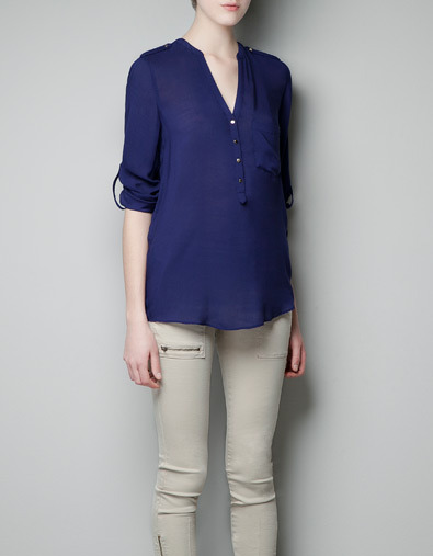 Blouse With Pocket - neckline: v-neck; pattern: plain; length: below the bottom; style: blouse; bust detail: buttons at bust (in middle at breastbone)/zip detail at bust; predominant colour: navy; occasions: casual, work; fibres: polyester/polyamide - 100%; fit: loose; sleeve length: 3/4 length; sleeve style: standard; trends: deep tones; pattern type: fabric; pattern size: standard; texture group: jersey - stretchy/drapey; season: a/w 2012