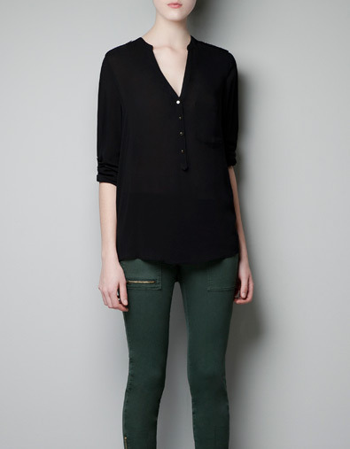 Blouse With Pocket - neckline: v-neck; pattern: plain; length: below the bottom; style: blouse; bust detail: buttons at bust (in middle at breastbone)/zip detail at bust; predominant colour: black; occasions: casual, evening, work; fibres: polyester/polyamide - 100%; fit: loose; sleeve length: half sleeve; sleeve style: standard; texture group: cotton feel fabrics; pattern type: fabric; season: a/w 2012